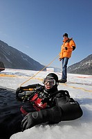 Ice_Diver at Surface with Safety Person, Lake Weissensee, Carinthia, Austria