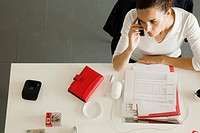 Businesswoman at desk making phone call