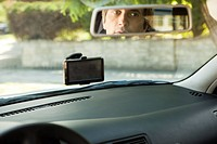 Driver checking rear_view mirror