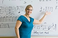 Woman teaching music theory class