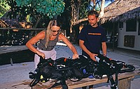 Diving teacher checks the rebreather, Indian Ocean Lhaviyani Atoll Kuredu, Maldives Island
