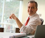 Caucasian businessman sitting at desk