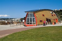 St Aubins Bay ST HELIER JERSEY La Frigate Cafe ship hull building promenade tourists walking