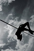 Silhouette of high jumper