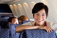 Young woman on an airplane (thumbnail)