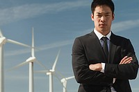 Businessman and wind turbines