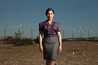 Businesswoman at wind farm
