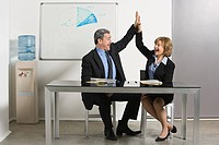 Businesspeople doing high five