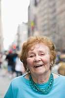 Portrait of senior woman in street