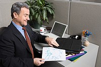 Businessman with doodle at desk