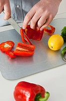 Man chopping peppers