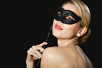 Young blonde woman wearing with black mask