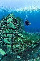 scuba diver between walls of the underwater mills, Lago di Capo d´Acqua, Abruzzo, Italy