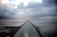 Jetty and storm clouds