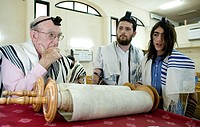 Bar Mitzvah ceremony in a synagogue reading the Torah