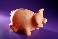 Hurted savings piggy bank, credit financial crisis metaphor