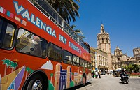 Bus tourist, on background 'Miquelet' or 'Miguelete' tower (built in 14th century), Cathedral. Valencia. Spain