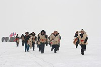 Fishermen running to start during Winter Fishing in Chagan Lake, Songyuan, Jilin Province, China