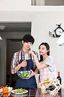Young couple preparing dinner together