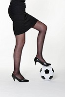woman wearing fishnet stockings and high_heels with soccer ball