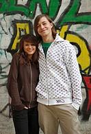 Wall, graffiti, teenagers, couple, gaze camera, smiling,