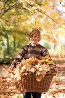 Teenagers, boy, gaze camera, smiling, basket, autumn leaves, holding, ,