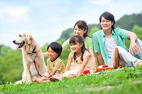 Family on a picnic with their dog