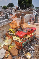 Malacca (Malaysia): burning gifts to the dead people, during the Ching Ming Chinese commemoration of the ancestors, in the Jelutong Melaka cemetery