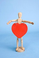 Heart shape hung on the wooden doll (thumbnail)