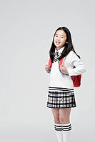 girl carry a school bag over her shoulder