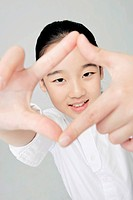 girl giving hand signal