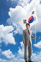 Businessman holing Korean flag, Taegeukgi (thumbnail)