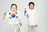 boy and girl holing Korean flag, Taegeukgi
