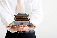 Businessman holding a Namdaemoon (thumbnail)