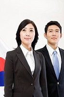 Businessman and businesswoman in front of Korean flag, Taegeukgi (thumbnail)