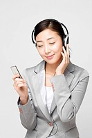 Businesswoman wearing headset (thumbnail)