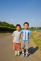 Brothers standing on a road, Machida, Tokyo Prefecture, Japan