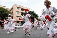 Cubans dancers during a parade in Havana, Cuba