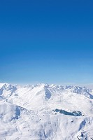Snowy mountain range and blue sky