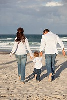 Fort Lauderdale, Florida, United States Of America, A Family Walking On The Beach