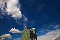 Alberta, Canada, Clouds In The Sky Above A Grain Elevator