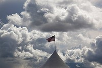 oregon, united states of america, the american flag flying under dark cumulus clouds