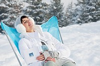 Young woman resting in snow