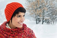Young woman in winter clothes smiling