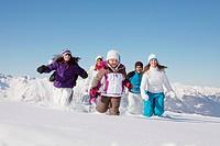 Happy family running in snow