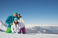 Couple and daughter in ski wear, looking away (thumbnail)