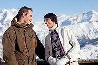 Young couple looking at each other, mountains in background