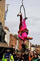 Dublin, ireland, an acrobat doing a performance in a parade on o´connell street