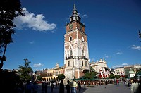 The 13th century Gothic town hall tower with tourists in rynek glowny town square krakow