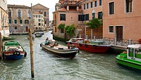 Venetian Canal with small boat to the front door, Venice